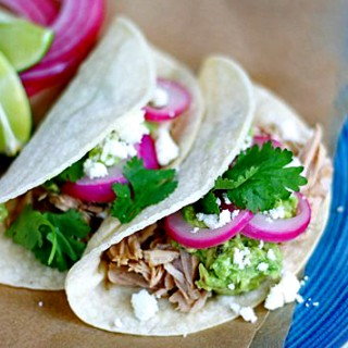 shredded pork tacos with quick pickled onions and guacamole